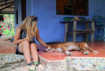Nina with a new furry friend in Colombia.