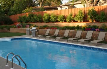 A photo of our backyard when we lived in the suburbs. Steve loves to garden, flowers and vegetables . Deb made sure the pool and hot tub were always clean and fresh.