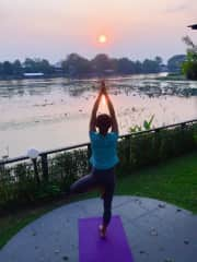 A sunset yoga session by the River Kwai in Kanchanaburi, Thailand