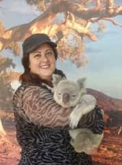 Giving a hug to a koala in Australia