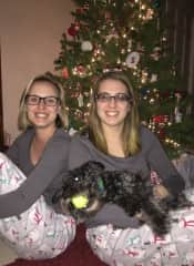 My sister and I with our parents' dog, Toby. (He wasn't interested in posing for the photo.) I've grown up with the breed and have raised three male, mini schnauzers with my family. I love all animals, but these dogs are a little extra special.