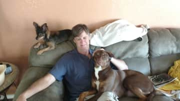 Kyle with 2 of our grand fur babies.