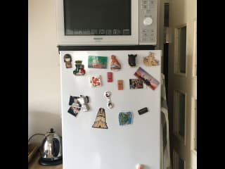 Stand-alone oven on top of fridge. (Step-stool available!)
