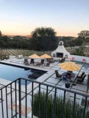 Looking down at pool from Courtyard large 10 acre vineyard in DeLuz California