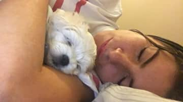 In this photo I am sleeping with Milo, it is so beautiful!