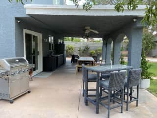 Side view of our patio showing BBQ, tables; the sliding door is going to the kitchen.