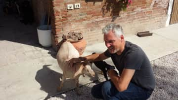 Nicolo with pet goat in Reggio Emilia, Italy