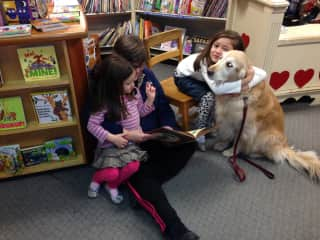 Me and my dog loving granddaughters reading at a local bookstore