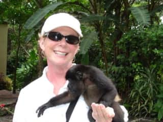 This is me in Panama with a young monkey we found stranded in the jungle.