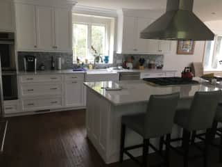 Open kitchen with professional cooktop and double ovens