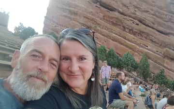 My husband and me attending a concert @ Red Rocks in Colorado