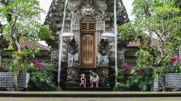 Andy and Rowan, taking a break while temple hopping in Bali!
