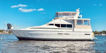 """Our """"floating home"""". She is a 47 ft Mainship Motoryacht docked in Jacksonville, FL. Her name is Straight from the Heart."""