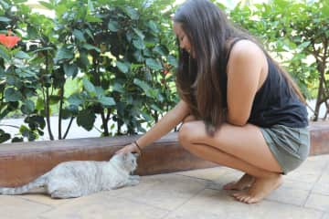 Christina loving on the sweetest kitty in Mexico!