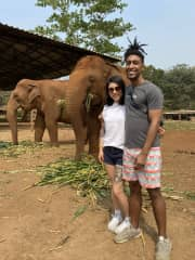 We love traveling! We went to an elephant sanctuary in Thailand where we got to feed rescued elephants and watch them from afar.