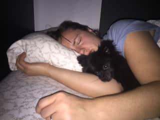 Nadja having sleep-hugs with Bugsley the Tea-Cup Pomeranian