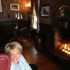 Kathrin feeling cosy at the fireplace. Mendocino Hotel.