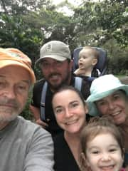 Our daughter, son-in-law and grandkids hiking in Maui last Christmas. David on left with vacation goatee, Cindy on right with blue hat.