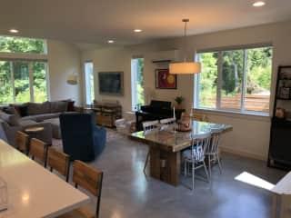 Dining room, living room, kitchen island.