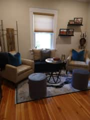The entertaining room includes a comfortable seating area for reading or enjoying coffee in the morning.