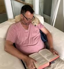 Stephen and Teddy relaxing with a book