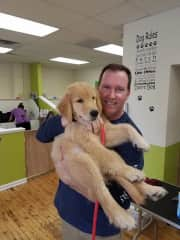 me and one cute puppy at our shop.