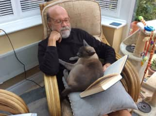 David with Benson in the UK . . . Reading or asleep???