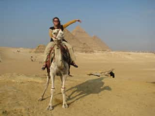 Riding with Moses, the camel, around the awe-inspiring Pyramids in Egypt