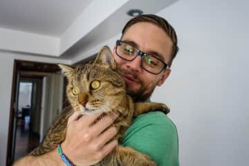 Greg with Finn while house-sitting in Porto Alegre, Brasil