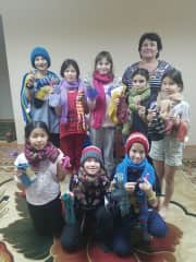 After adopting our first two children, we started a charity to help the orphanage. We now help two orphanages in Kazakhstan. I travel twice a year carrying 300 pounds of warm hand knits each time as well as other donations.