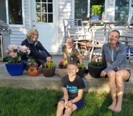 Jill's family being photo bombed by Annie the Chocolate Lab.