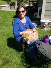 Dianne and cat friend enjoying the sunshine.