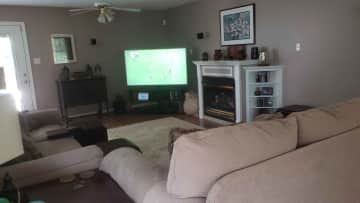 The living room with 65 inch TV.