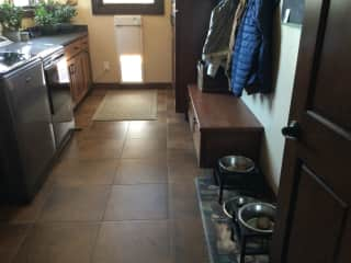 The laundry room where the dogs are fed and watered. The doggie door works well for Jackson. Quincy is still learning.
