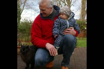 Heinz with his granddaughter and a visiting cat from the neighbourhood.