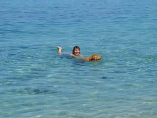 Me swimming with Oscar who I often sat for in the good old days in Corsica....he went to Rainbow Bridge also in 2018.