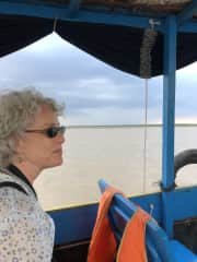 On a boat heading into the Tonle Sap, in Cambodia