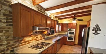 Galley Gourmet Kitchen (Fridge, oven, microwave)