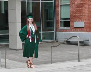 Leanne graduating from the University of Oregon with a degree in Journalism