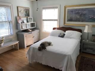 Bedroom with double bed and Rosebud. A full bath is attached.