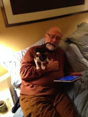 My husband Larry cat sitting a Cornish Rex