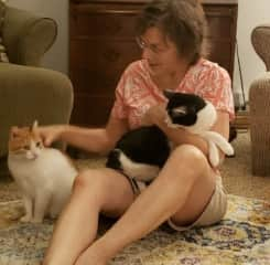 Mary hanging out at our home with our pets, Paige and Loki.