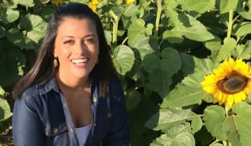 I'm a HUGE nature lover. Here I am at a sunflower farm - August 2020.