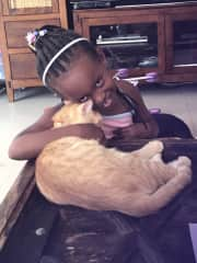 My daughters with our cat tigger