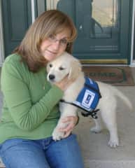 Me with Angel.  I trained her as a service dog for Helping Paws for two years.  When she became too attached to me emotionally, she was released  from training and given to me.  She has been my pet ever since.