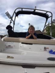Lola with our Grandson on our boat 7/18