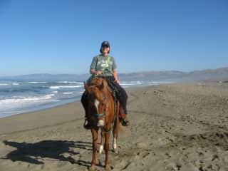 I am riding Goofy on the beach on the California coast.