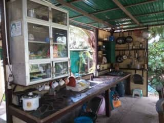 This is the working part of the kitchen. Cooking Thai food requires very very  good ventilation. There is a big refrigerator not in the photo.