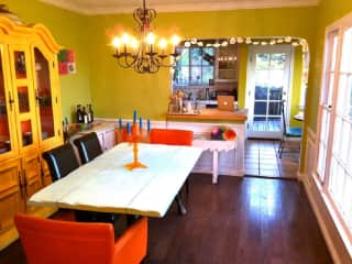 Open dining room with full southern views connects cutting block kitchen peninsula with living room. Has small window AC unit.