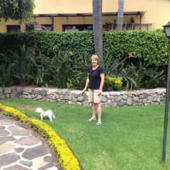 Glenda walking Abby in Mexico